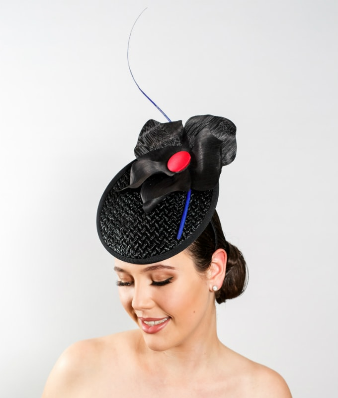 black-vintage-straw-cocktail-hat-with-black-silk-abaca-flower-red-centre-and-blue-barb