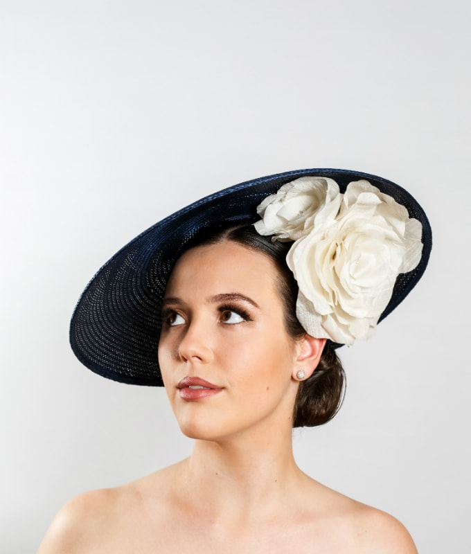 navy-straw-hat-with-three-white-silk-roses