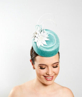 turquoise-cocktail-hat-with-white-leather-flowers-and-ostrich-barbs