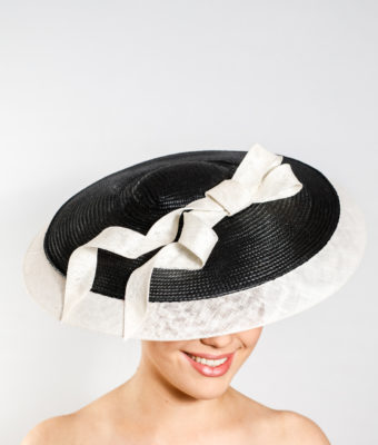 Black straw brim with white sinamay extension and trim