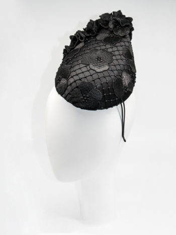 Black lace cocktail hat with lace flower trim $480