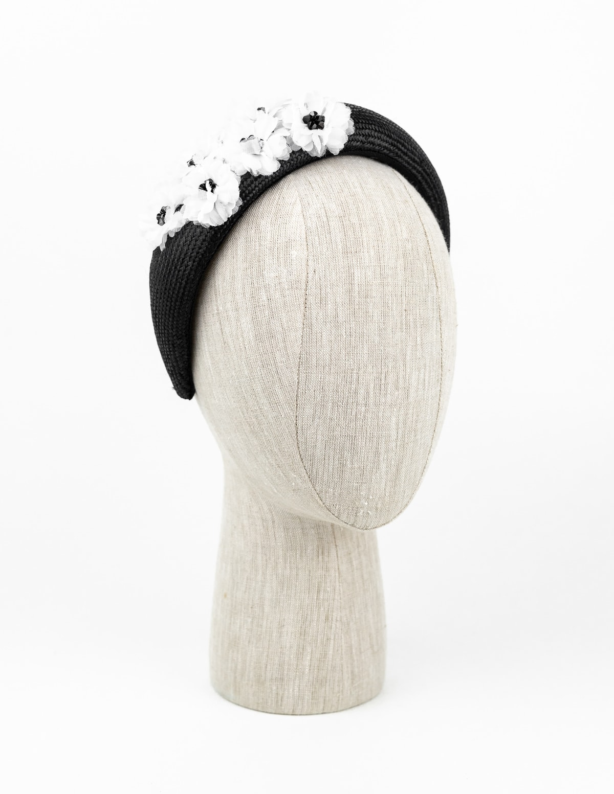 Black straw headpiece with white petal flower and black Swarovski crystals $420
