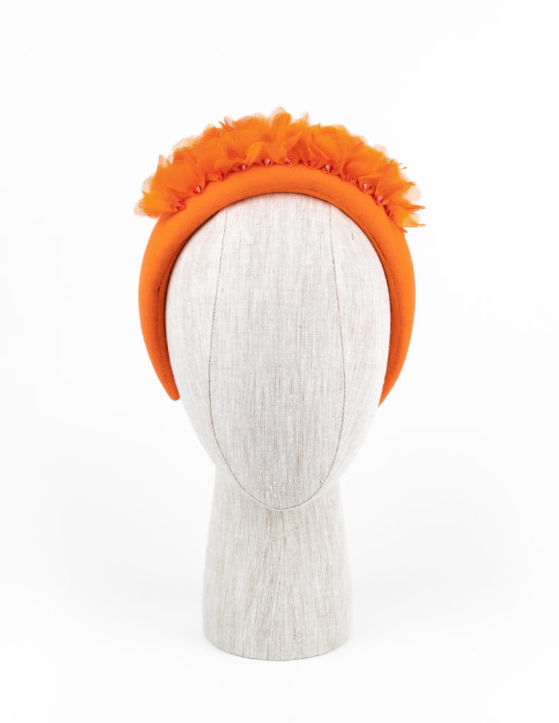 Orange fur felt headpiece with silk petals and Swarovski crystals $440