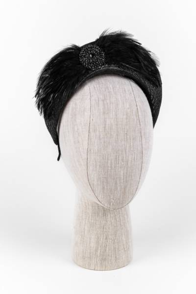Black straw tudor crown with feathers and brooch trim
