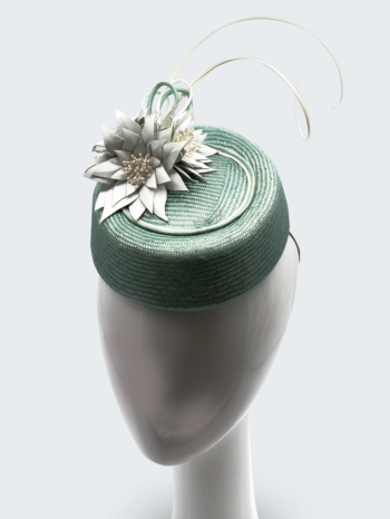 Turquoise  straw  button  with  white  leather  flowers  $440